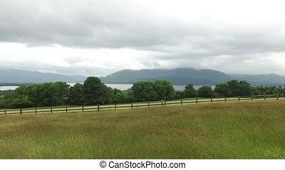 view to lake and farmland at connemara in ireland 53 -...