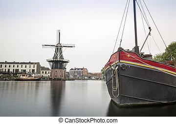 Haarlem by the canal with windmill, The Netherlands - Cute...