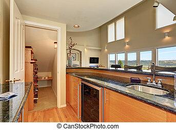 Modern style kitchen interior with wine storage room...