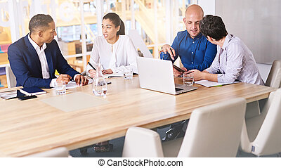 involved discussions between business executives in meeting...