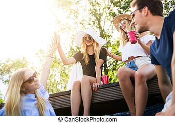 High five - A photo of group of friends spending their time...