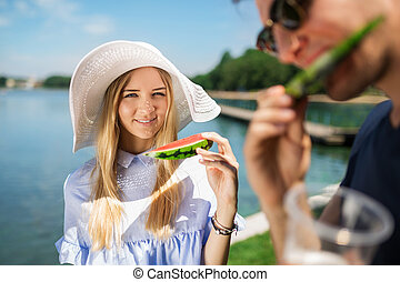 Fresh and tasty - A photo of young, beautiful woman in...