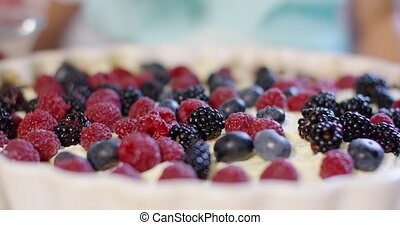 Fresh homemade fruit pie with assorted berries on a whipped...