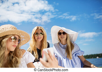 Girls on holiday - A photo of three young women relaxing in...
