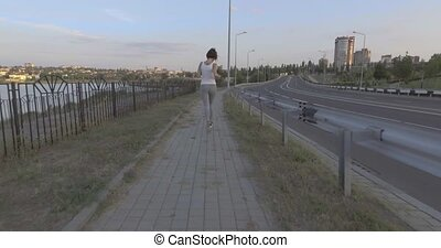 a girl while jogging in park - a girl while jogging in the...