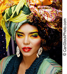 beauty bright woman with creative make up, many shawls on...