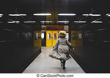 I missed the train - Rear view of businesswoman running to...