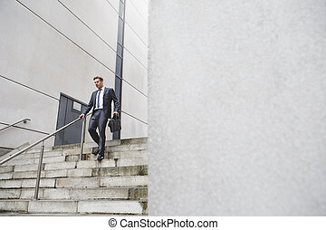 Businessman on the stairs - Businessman on his way to work....
