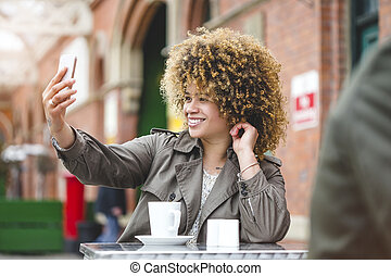 Train station selfie! - Woman taking a selfie on a...