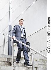 City Businessman Running Late - Formal businesssman walking...