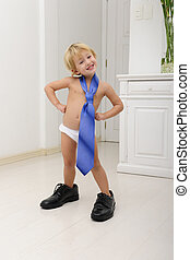 Corporate succession: child with tie and shoes posing -...