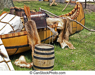 Early Trading - Fur pelts in Indian canoe.
