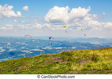Skydiving extreme over the mountains - Four persones...