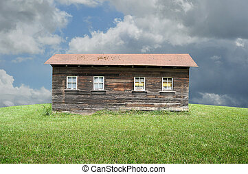 Old Shack - An old shack in a big empty green grass field.