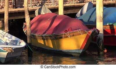 Rowboat Floating In River At Pier