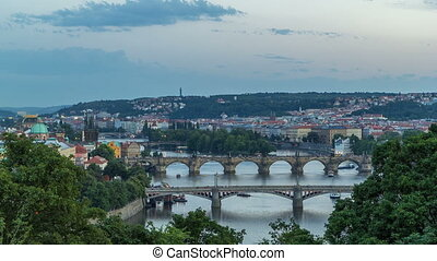Scenic view of bridges on the Vltava river day to night timelapse and of the historical center of Prague: buildings