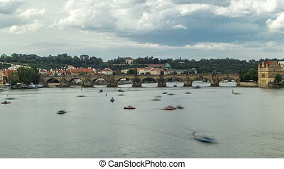 View of the city Prague in Czech Republic with colorful paddle boats timelapse on the Vltava river on a beautiful day
