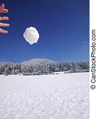someone throwing snowball - someone is throwing a big...
