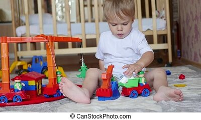 the child plays with the toys in the playroom - the...