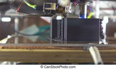 Affordable 3d printer printing with black plastic filament,...
