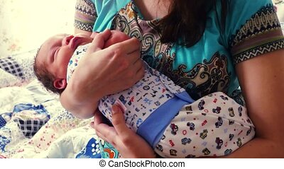 Mother holds newborn baby Maternity concept 4k 3840x2160 -...