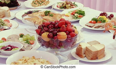 Tasty fruit - peaches, cherries, cherry on table. - Tasty...