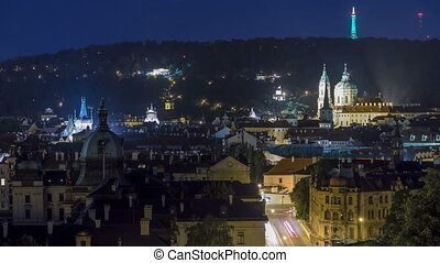 night view of the church of saint nicolas with petrin hill behind it timelapse.