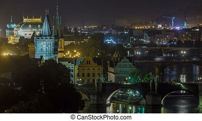 Scenic view of bridges on the Vltava river night timelapse and of the historical center of Prague: buildings