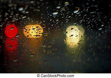 Rain drops with bokeh effect in the night city.