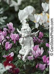 Angel figure and flowers
