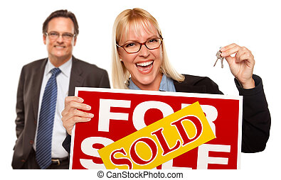 Man with Blonde Woman Holding Keys and Sold For Sale Sign -...