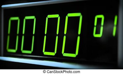 Digital clock watch. Counter with green digits. - Macro shot...