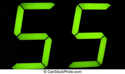 Macro digital watch counter timer. Green digit. - Close...