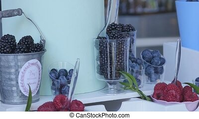 tasty berries on the wedding buffet table decorated with...