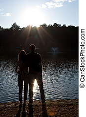 Back Lit Couple Silhouette - Silhouette of an affectionate...