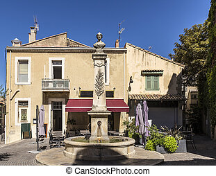 old fountain in salon de provence under blue sky
