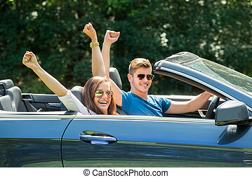 Couple Sitting In A Car Wearing Sunglasses - Happy Couple...