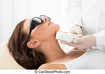 Woman Receiving Laser Hair Removal On Neck - Close-up Of A...