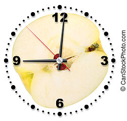 Single cross of yellow apple as a office clock. Close-up....