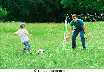 Kid Playing Football With His Father
