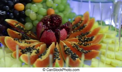 Colorful Tropical Fruit Buffet with drinks - Colorful...