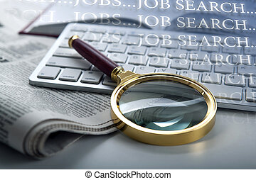 inscription job search and a magnifying glass on newspaper...