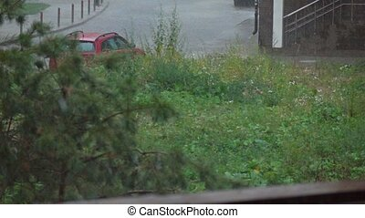 Heavy rain in residential area, super slow motion shot -...