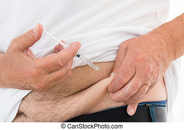 Diabetic Man Injecting Stomach - Close-up Of A Diabetic Man...
