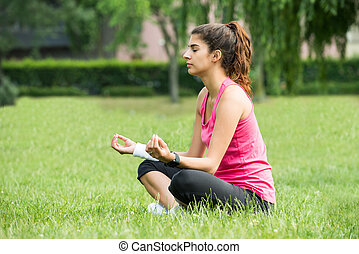 Woman Doing Meditation - Young Woman Sitting On Grass...