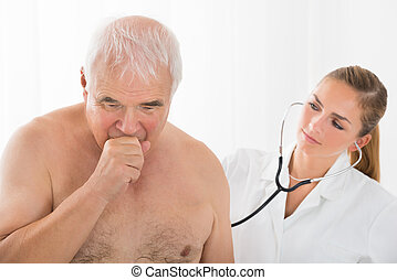 Doctor Using Stethoscope On Patient's Back - Young Female...