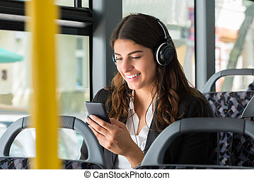 Businesswoman With Cellphone Listening Music - Smiling Young...