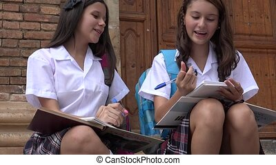 Teen Girls Writing At School