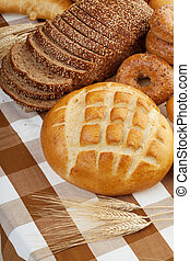 fresh baked bread - Assortment of baked bread on a table...