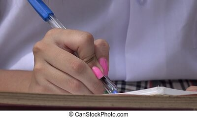 Female Writing In Notebook